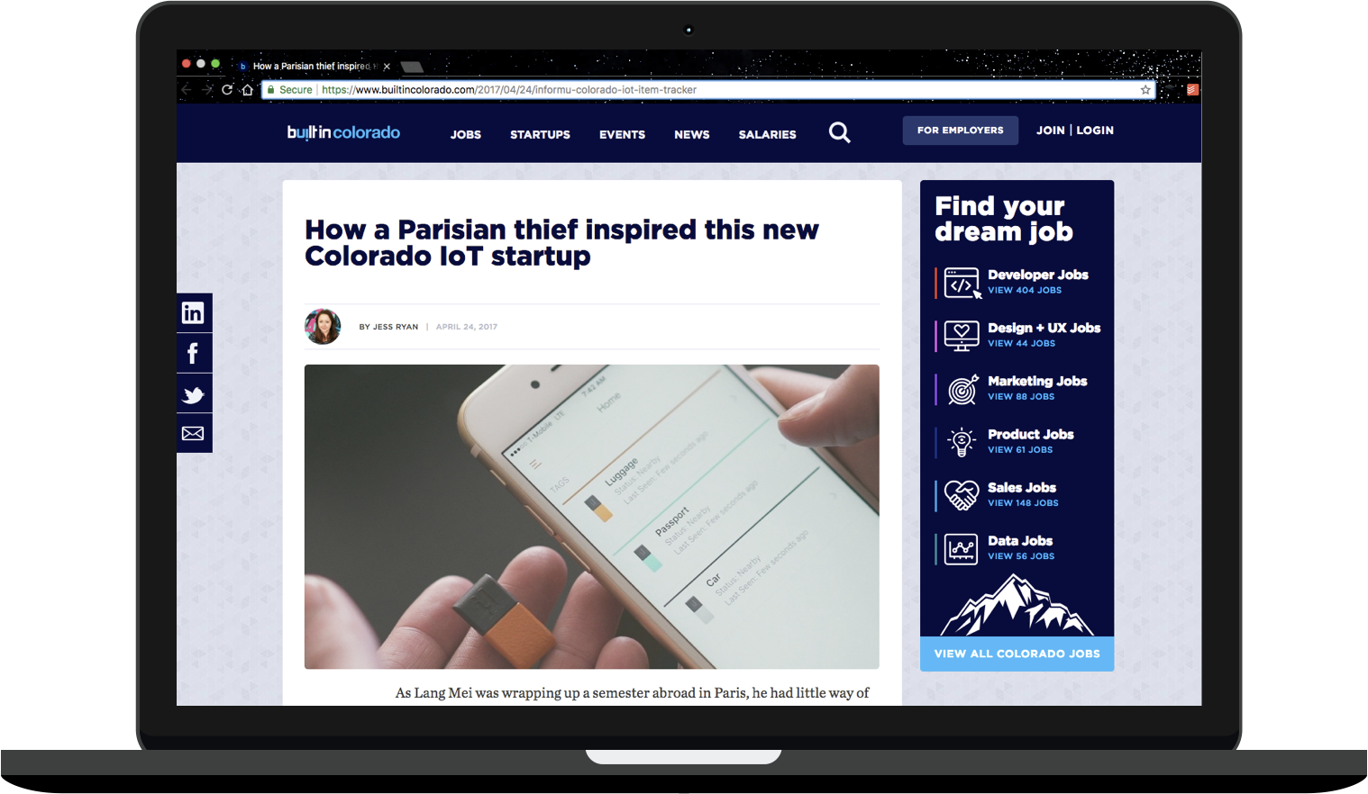 "MacBook mockup depicting an article on Built In Colorado titled ""How a Parisian thief inspired this new Colorado IoT startup."" Jess Ryan is listed as the author, and a photo below the headline depicts a cell phone and a small, rectangular IoT device."